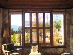 Plantion shutters used to block the sun on the outdoor lobby of this Dude Ranch