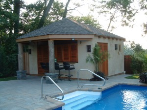 Exterior shutters and doors on a pool-side cabana